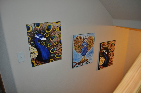 The finished products hanging proudly on the wall!  From left: Jen's peacock, Dad's peacock, Mom's peacock